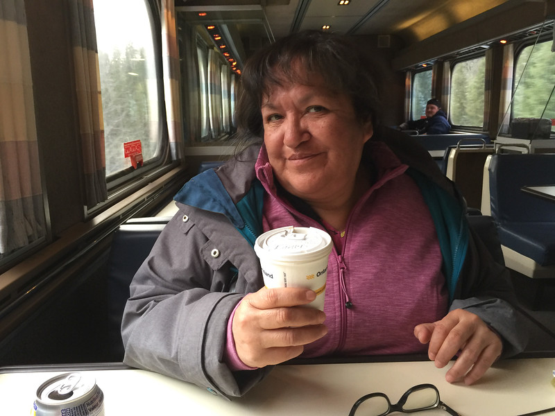 Denise Lantz having coffee on train south