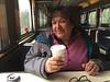 Denise Lantz having coffee on train south