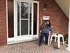 Denise Lantz on the phone on front patio.