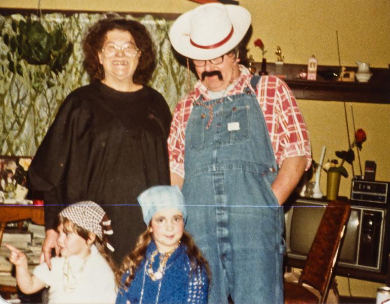 Merideth, Leroy, Beth, and Jenny. on Halloween.
