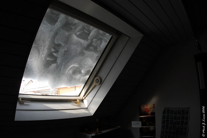 During the snow storm, the snow had piled up on Max's window into some interesting patterns.