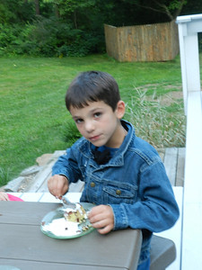 Carson likes the cake and his Mom's homemade ice cream