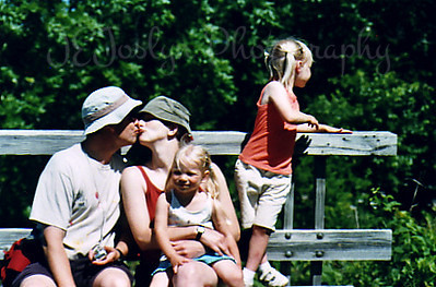 Pa, Ma and C, G watching a bug. Great River Bluff State Park, Winona, Minnesota, June, 2005.