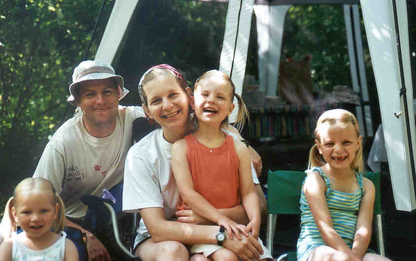 Camping at Great River Bluffs State Park, Winona, Minnesota.  June 11, 12, 13, 2005.  Rain on 11, sun on 12, and rain again on 13.  Also, very large RED bodied 'daddy long leg' spiders that were truly unaccaptable to middle child above.  She was frightened unconsolably, to the distress of all, and even some neighboring campers.  Screen porch/tent was a great addition because of the few bugs and rain.