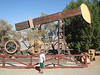 Henry in front of pumpjack at Kern Oil Museum
