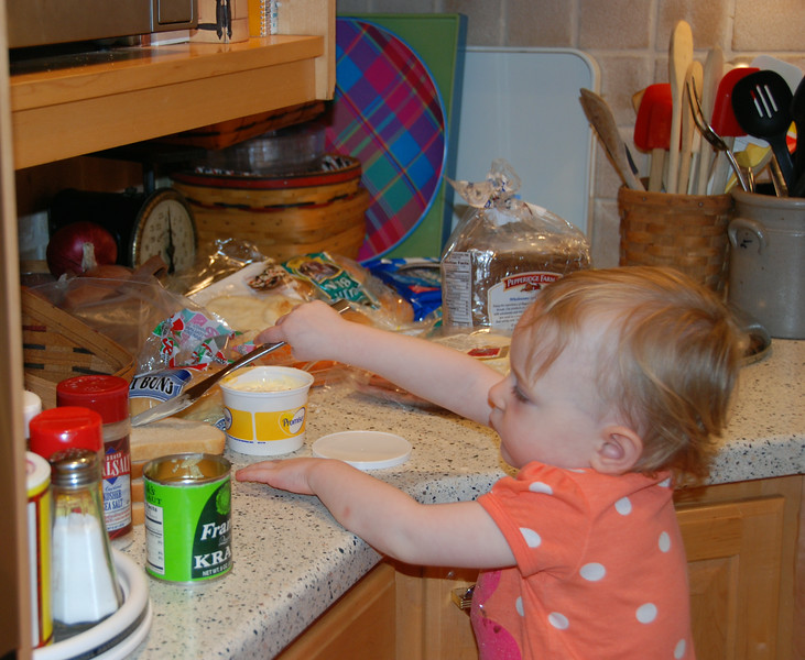 Helping Mommy make Reubens. I spread the butter.