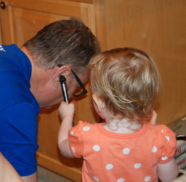 Checking Papa Mike's ears.