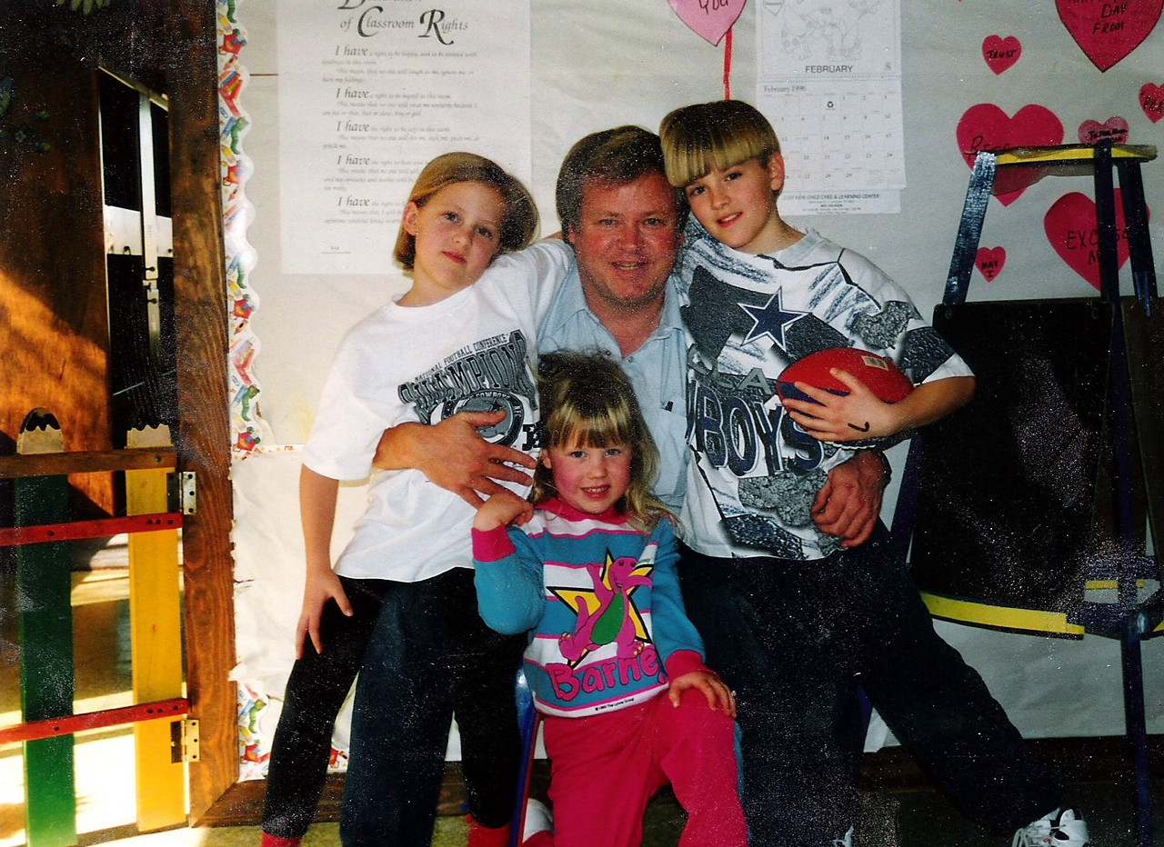 Daddy, Sarah, Katie, Luke.  Supporting each other through some tough times.  This was taken during one of the most stressful times of our life.  But we stuck strong together, took care of each other and love was our bond.