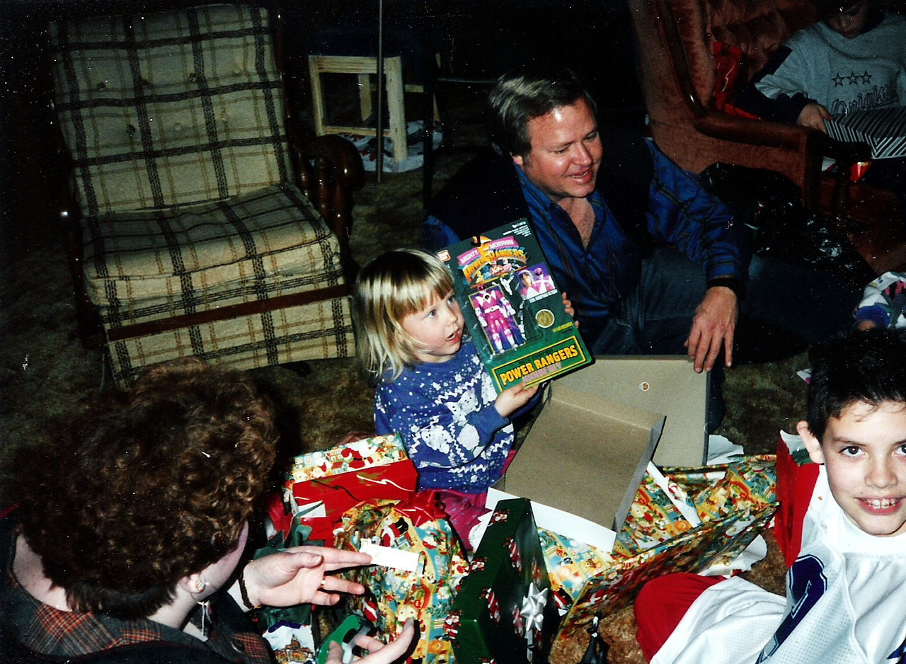 Must be Christmas.  Katie got a Power Ranger.  Dad and Chad look on.