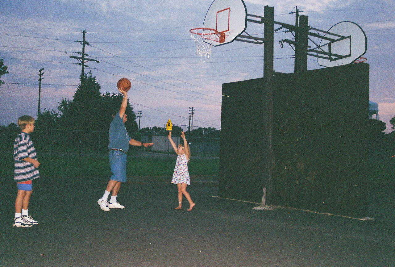 Luke, Dad, and Katie play some round ball.
