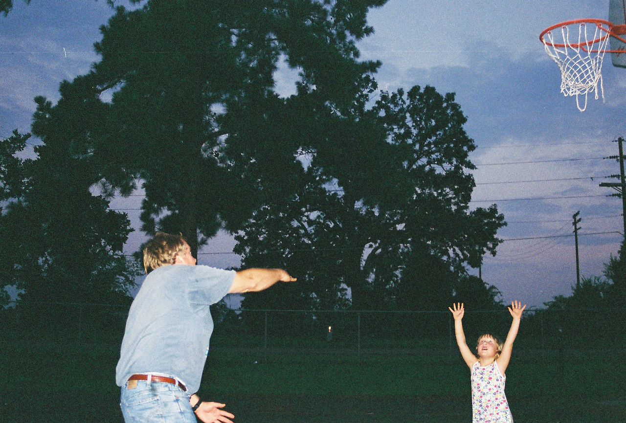 Dad hooks shots over Katie who leaps high for the ball.