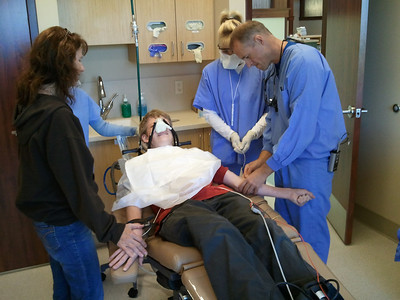 Mom holding Spencer's hand while the doctor finds a vein. Looks painful!