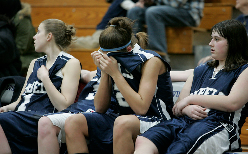 spt tt how loss<br /> Members of the Lady Rebels show saddness after their loss to Central Trenton in the sectional finals at Sayreville High School.<br /> 3-6-07 Scott P