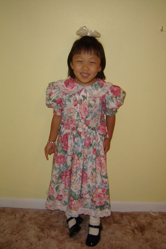 Abby wearing the dress Grandmother made for Katy to wear at my wedding in 1993