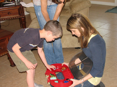 Tyler couldn't wait to show Courtney his new Cars Race Track suitcase.