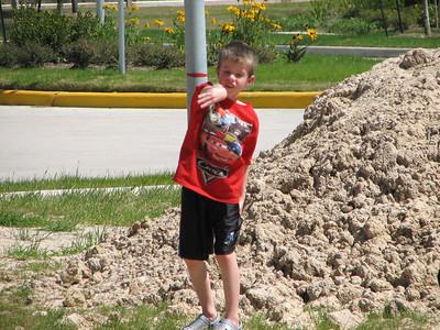 Tyler loves throwing rocks.