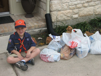 Garrett with the food drive items he collected in the neighborhood.