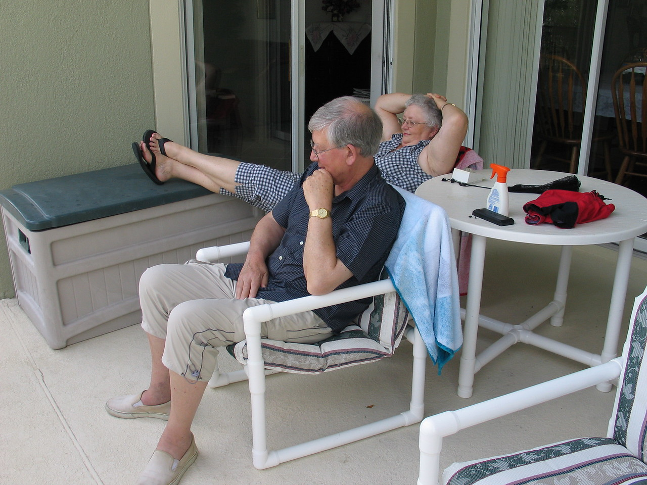 Grandma and Uncle Ray from Great Brittan hanging out on Grandma's porch, watching the kids swim.