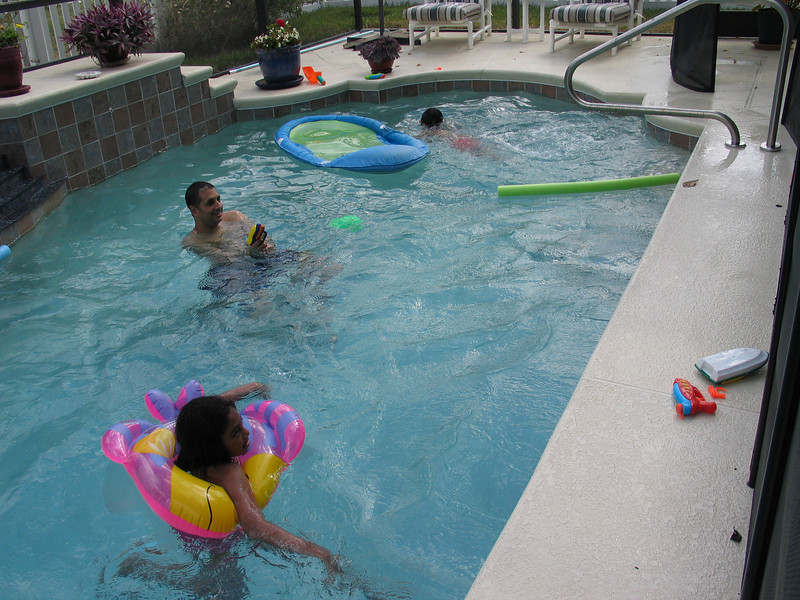 Kids all swimming in Grandma's pool.  Yep that's me, the big kid with the water pistol trying to get the adults wet.