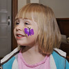 Eve showing off her butterfly face paint after the preschool open house.