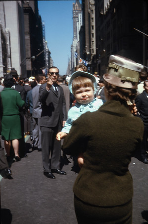 """""""That Hat!""""  Easter Parade '63, N.Y.C.  Liuz in green.  Dave in hat."""