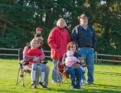 Kaitlyn, Aunt Raylene, Granma Barrett, Ava and Amanda, and Uncle Stephen watching the season's last soccer game.