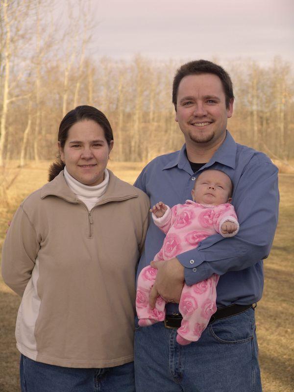 Meredith, Steve, and Journey. Taken outside Steve's dad's acerage near Ardrossan, AB.