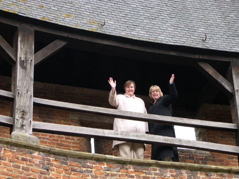 Susan and Kathy waving from the castle ramparts.