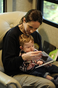 Reading with Mom.  (Yes, I was as tired as I look.)