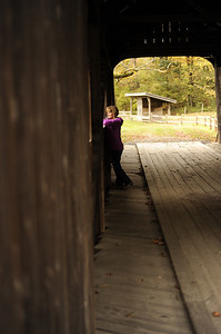 Karen Dierking in covered bridge at old Grafton Village Cheese Co. grounds.