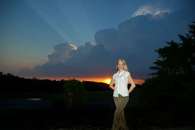 Kate poses in front of a gorgeous sunset.  (Kate is georgeous too.)