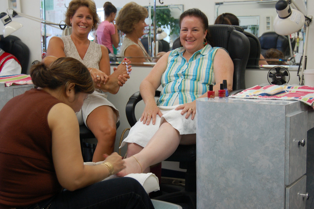 The cousins wanna look pretty too: quick pedicures on wedding day.