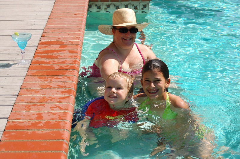 Jill left her cocktail poolside while taking this picture - Mikey, Megan and Ann.