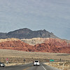 Calico Hills, from the highway.  The car at left is just leaving the scenic loop.