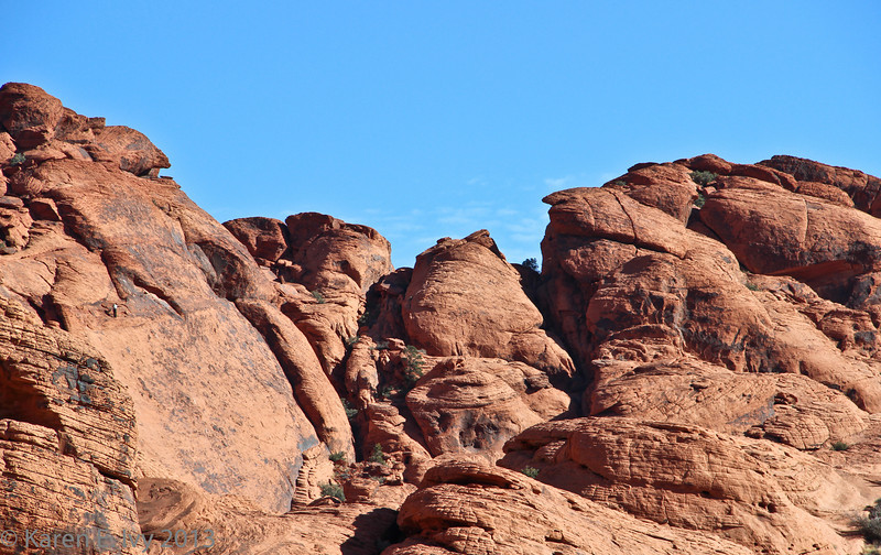 Calico Hills.  Note the solitary climber on the left face.  How did he GET there??