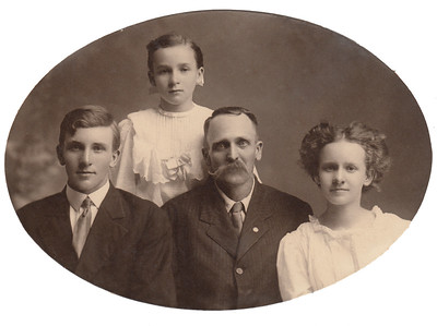 Milford Charles Bowyer, Ocal Gladys Bowyer (Standing), Horace Avery Bowyer, & Mable Marie Bowyer