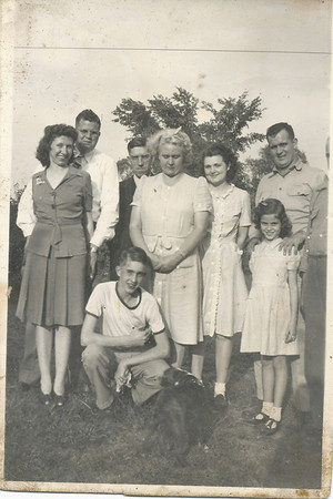 From right to left: Mary Gene & Lawrence Sullivan, Ora Dallas Clark, Kenneth Clark (Crouching), Iona Sullivan, Jean Keirn, Janet Sullivan, Ellis Sullivan, and a bit of Seward Sullivan.