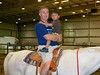 Dillon learning to enjoy riding a horse with PaPa