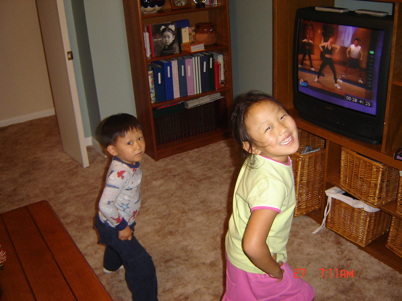Abby and Dillon doing aerobics in the living room.