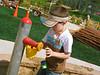 John David pmping water at the park.