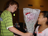 Carter gives Abby roses at the recital