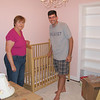 Susan and Jim assembling Charlotte's crib in her new room.