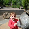 Charlotte always loves to spend time playing with the panda sculpture at the Zoo.
