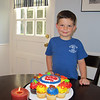 Carter with his birthday cake at home.