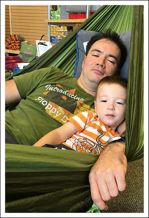 Aiden and Papa trying out the hammocks at REI