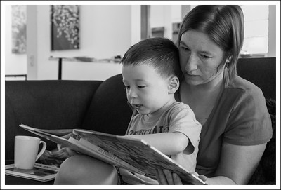 Aiden, reading with Mama.