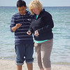 Anh and Amy on the beach picking up Petoskey Stones.