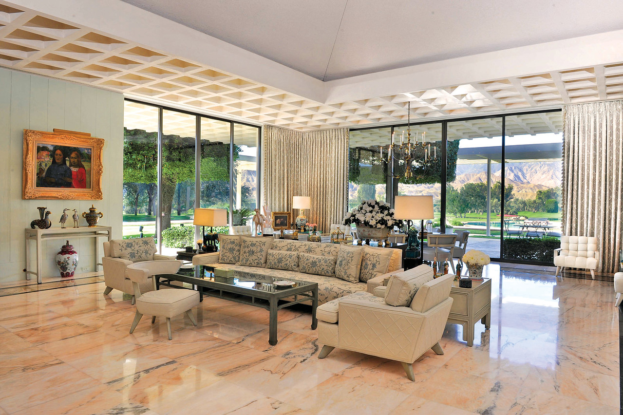 The living room, with pink marble floor, and furnitirue designed by William Haines. Photo by Ned Redway copyright The Annenberg Foundation Trust at Sunnylands.