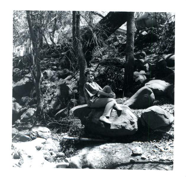 susan sitting on rock