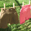 Dark Olive Shorts (with multi-colored flecks): 100% wool  (sold!)<br /> Hem is rolled over, not ruffled<br /> <br /> Pink Cable Shorts: 55% shetland wool, 45% merino wool  (sold!)
